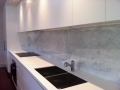 Essa stone benchtops and imperial white marble splashbacks
